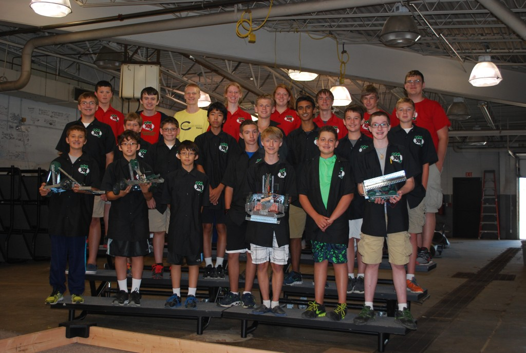 The Workshop Students proudly display their robots with the Walled Lake Robotics Team Coach/Mentors