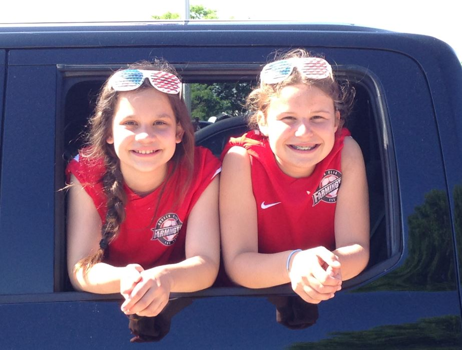 Parade GirlsRiding in Truck